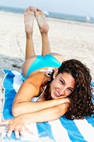 USA, New Jersey, Ocean City, Portrait of smiling Woman in bikini lying on beach