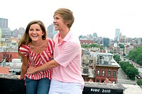 USA, New York, Manhattan, Teenage couple embracing on rooftop