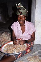 Gum Arabic  Nigerien Woman Removing Straw and Dirt by Hand from Gum Arabic Collected in the Field  Niamey, Niger, West Africa