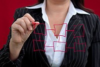 Businesswoman With Red Drawing Chart