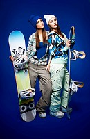 two girls with snowboards