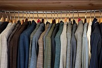 private men´s wardrobe full of men´s jackets, color image