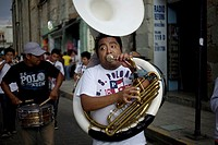 A man plays the tuba in a music band during the Convite of the Carmen Alto neighborhood, in Oaxaca, Mexico, July 12, 2012, in this tradition of the Ca...
