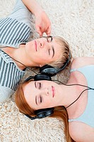 Couple of tee gers listening to music