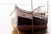 An empty boat moored