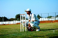 Wicket keeper behind the stumps