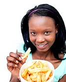 Charming young woman eating fries