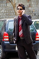 A businessman talking on his mobile phone