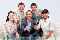 Business team celebrating a success with champagne