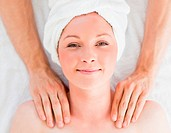 Closeup of a cute red_haired woman receiving a massage in a spa