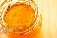 Top angle view of a spoon in a jar of marmalade