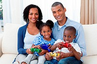 Smiling Afro_american family playing video games