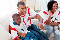 Excited Afro_American family wathing a football match