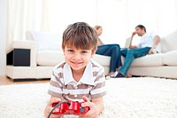 Adorable little boy playing video games