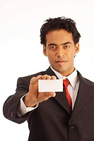 A Businessman holding a label