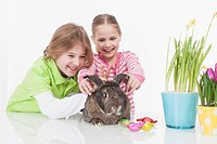 Girl and boy with easter bunny, smiling