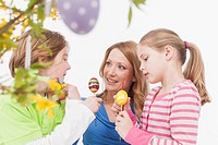Family with easter egg, smiling