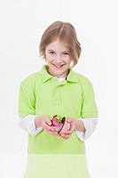 Boy holding easter egg, smiling, portrait
