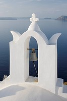 Greece, Bell tower in front of caldera at Oia