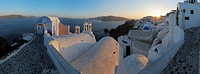 Greece, View of Oia village with cobbled path, roof and bell tower of Greek Orthodox Church at Santorini
