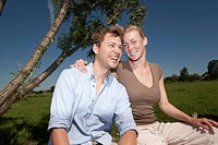 Germany, North Rhine Westphalia, Duesseldorf, Couple relaxing, smiling