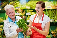 Germany, Cologne, Womens with celery in supermarket (thumbnail)