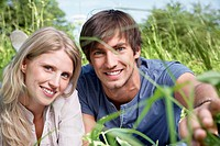 Germany, Cologne, Young couple smiling, potrait