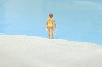 Figurines woman standing on beach