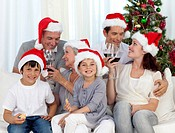 Family celebrating Christmas with wine and sweets at home