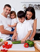 Cute son preparing food with his family