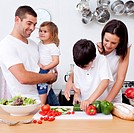Boy preparing food with his family