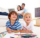 Children painting in living_room and parents on sofa