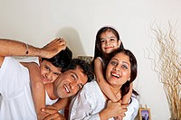 Children enjoying with their parents