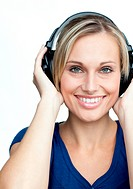 Portrait of girl listening to music on headphones