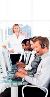 Female leader ma ging her team in a call center