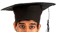 Partial view of a young man wearing mortar board