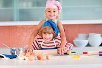 Lovely children baking at home