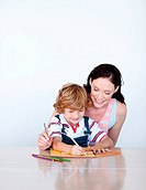 Joyful mother drawing with her son