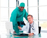 Senior doctor and young surgeon studying an X_ray