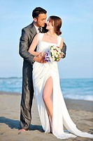 romantic beach wedding at sunset