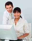 Afro_American businesswoman and caucasian businessman in the office