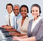 Multi_ethnic business people with headset on in a call center