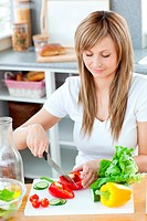 Delighted woman preparing a meal in the kitchen