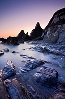 Twilight on the secluded rocky cove at Westcombe Beach, South Devon, England, United Kingdom, Europe