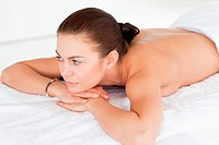 Close up of a woman lying on her belly on a massage table