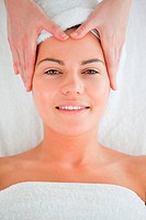 Portrait of a smiling woman enjoying a facial massage