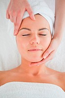 Portrait of a woman enjoying a facial massage