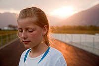 Young girl in sunset backlit
