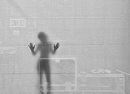 Woman Silouette with her Hands at the Wall