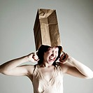 Woman playing with paperbag